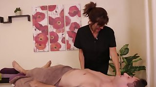 Client doesn't expect the dominant masseuse to give him a handjob