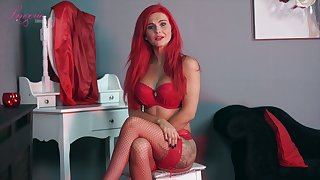 Sexually charged red haired woman Roxi K tells erotic N in sexy lingerie