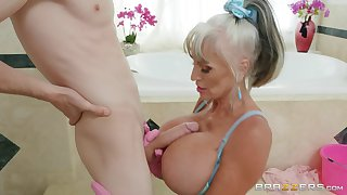 Busty mature tries a young dong up the brush thirsty mouth