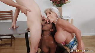 Busty mature loves helping this ebony babe with the big dick