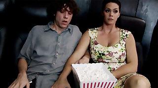 Sex-crazed milf touch shy stepson's dick in cinema